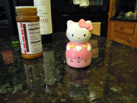 "Hello Kitty timer says ""15 minutes, then turn the chips"""